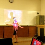 roxanne darling in front of the projector while speaking