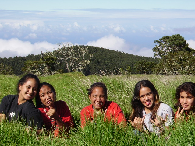 photo of kids on a Puakea Foundatoin camping trip to plant koa trees