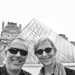 Shane and Rox in front of the pyramid at The Louvre
