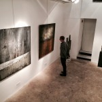 The artist, Shane Robinson, gazing at the work of painter, Yan Marczewski